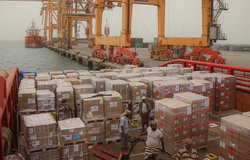 Photo credit: UNICEF/June2018. A ship berths in Hudaydah port and emergency humanitarian supplies sent by UNICEF are offloaded.